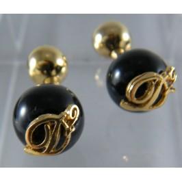 DSquared2 gemelli eleganti in oro e nero, sinonimo di eleganza e raffinatezza